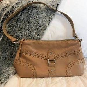 Tan Sereta purse with front buckle feature